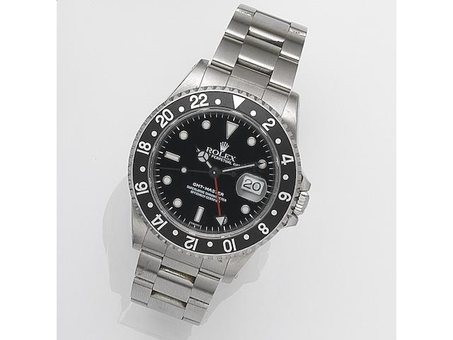 Rolex. A stainless steel automatic calendar bracelet watch GMT-Master, Ref:16700, Serial No.A44****, Movement No.382*****, Sold 9th August 1999
