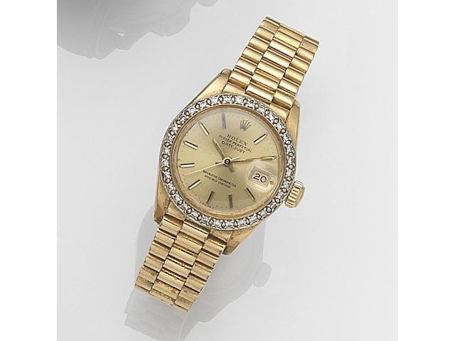Rolex. A lady's 18ct gold and diamond set automatic calendar bracelet watch Datejust, Ref:6917, Serial No.643****, Movement No.866***, Circa 1980