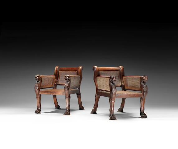 A pair of Regency carved mahogany library bergères in the manner of George Smith