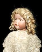 A Kämmer & Reinhardt 114 'Gretchen' bisque head character doll