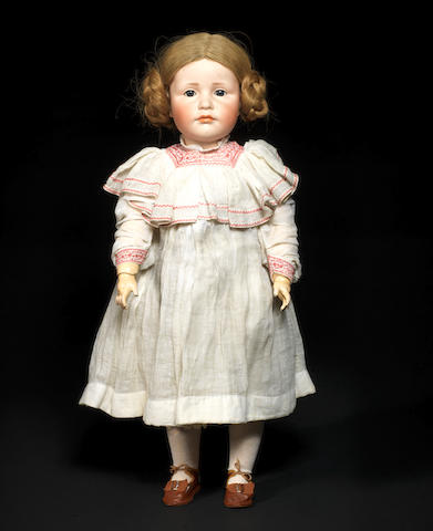 A Kämmer & Reinhardt 114 'Gretchen' glass eyed bisque head character doll