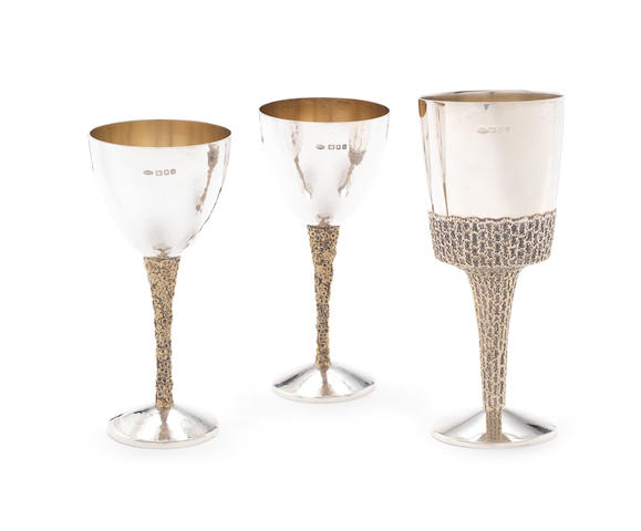 STUART DEVLIN: A pair of silver and silver-gilt goblets London 1976 together with another silver and silver-gilt goblet, by Stuart Devlin, London 1973 (3)