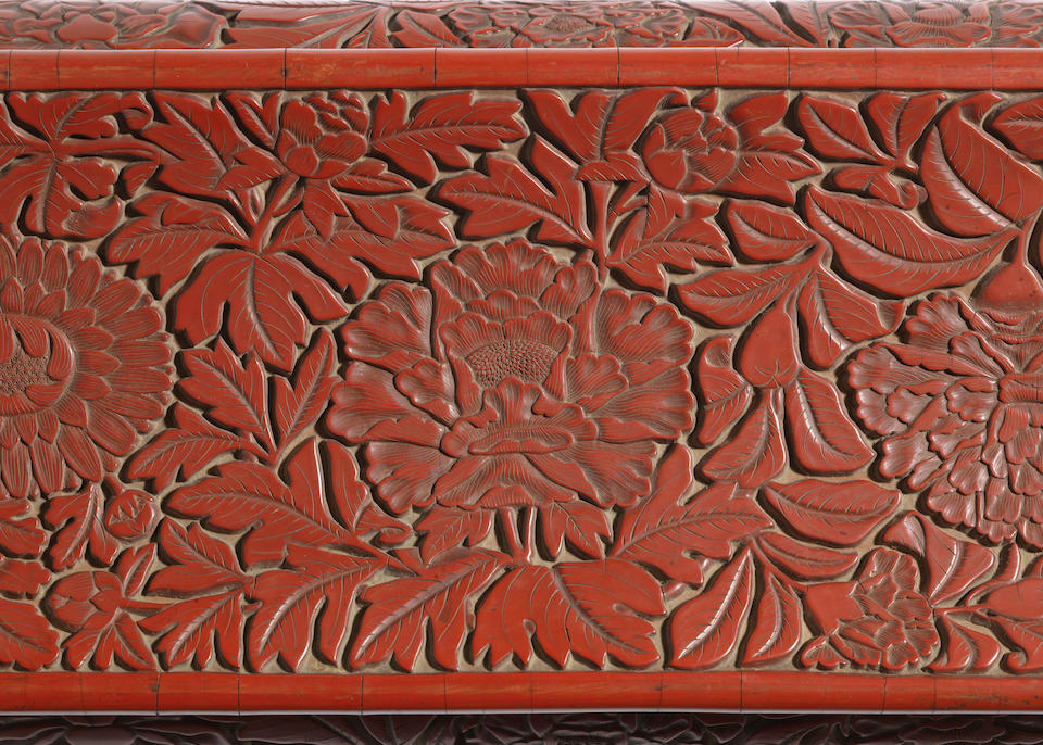 An extremely rare large cinnabar lacquer 'flowers' scroll-rest Early Ming Dynasty, 15th century