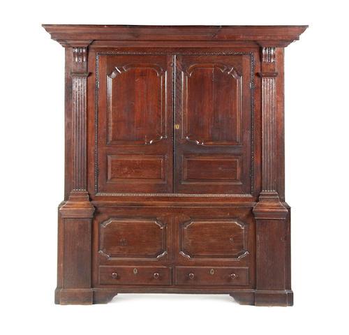 An unusual mid-18th century oak livery cupboard, English, circa 1740-60