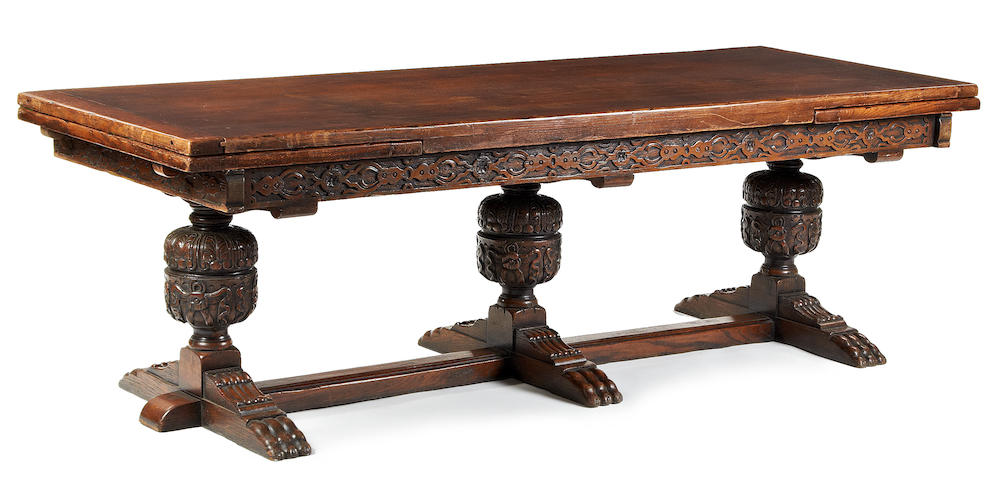 A large Elizabethan-Revival oak draw-leaf table 20th century