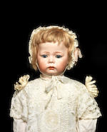A Kämmer & Reinhardt 115A bisque head toddler character doll