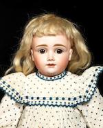 A J.D Kestner A.T type bisque head doll