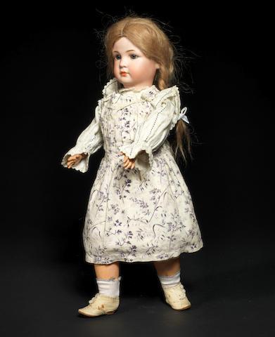 A rare Simon & Halbig 1448 bisque head character doll