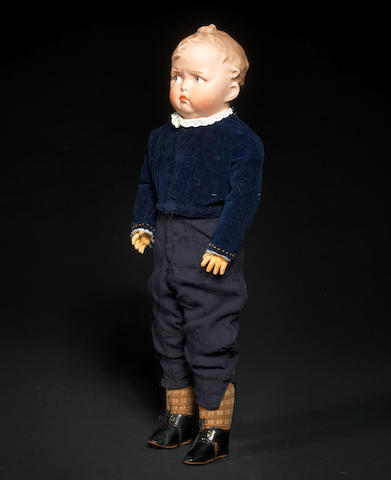 A Heubach 'Pouty' bisque shoulder head character boy