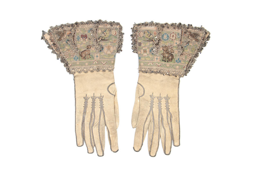 A pair of early 17th century gloves with unusual tapestry decorated gauntlets