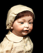 A large Kämmer & Reinhardt bisque head character baby with glass eyes
