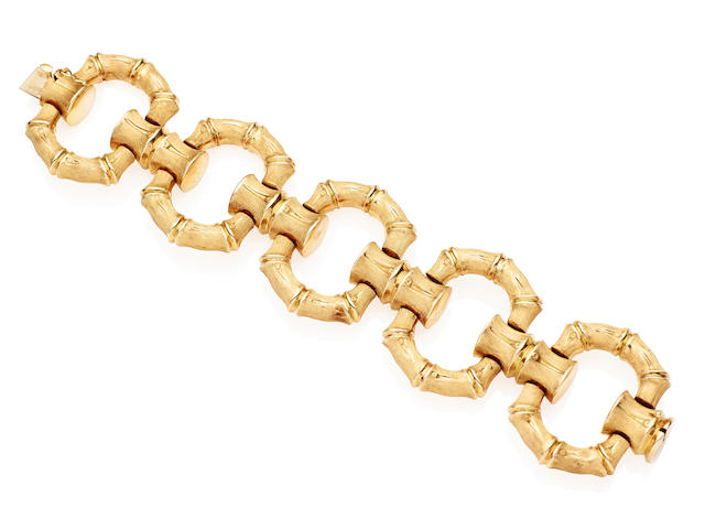 A gold cocktail bracelet, 1960s