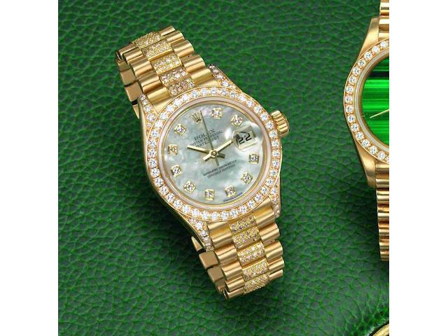 Rolex. A lady's 18ct gold and diamond set automatic calendar bracelet watch Datejust, Ref:79158, Case No.K555409, Movement No.1000542, Circa 2001