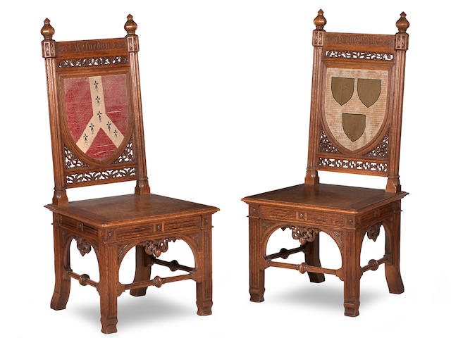 In the manner of A.W.N.Pugin, A pair of Gothic Revival oak hall chairsSecond quarter 19th century, possibly made by J.G. Crace