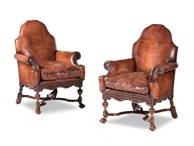 A pair of leather upholstered armchairs