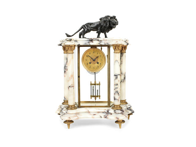 A late 19th century French gilt metal and veined white marble four glass portico clock