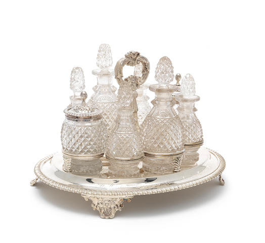 A George IV silver and cut-glass eight bottle cruet by Edward Barton London 1824, silver bottle mounts by T J & N Creswick, Sheffield 1819 & 1821