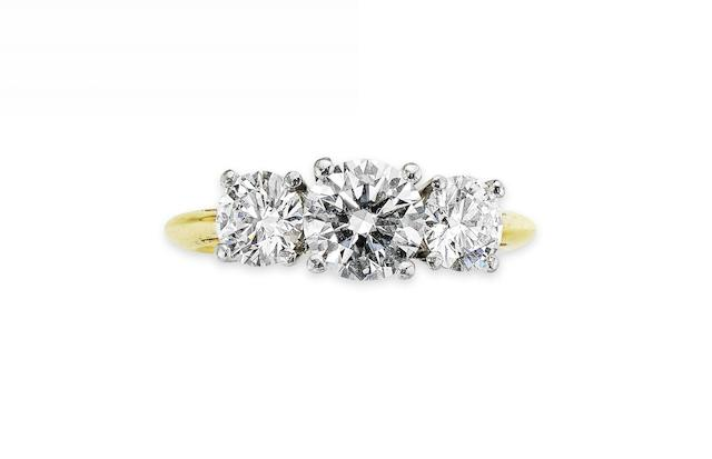 A diamond three-stone ring, by Tiffany & Co.