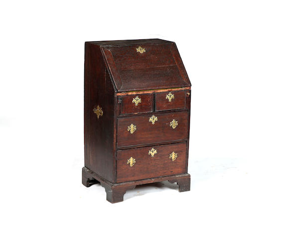 An unusually narrow George II oak bureau