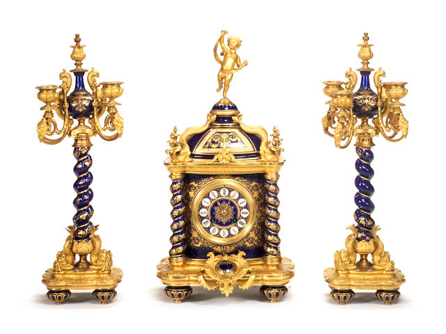 A late 19th century gilt bronze mounted porcelain French gilt bronze and porcelain clock garniture the movement signed Japy Freres 3