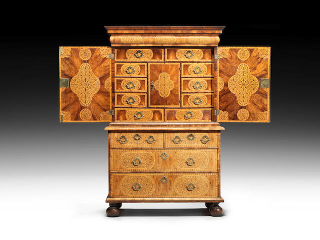 A William and Mary oyster kingwood and seaweed marquetry cabinet on chest in the manner of Gerrit Jensen