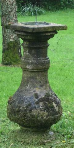 An early 20th century carved garden sun dial base with bronze sundial  The dial by T. Howes, Marlborough