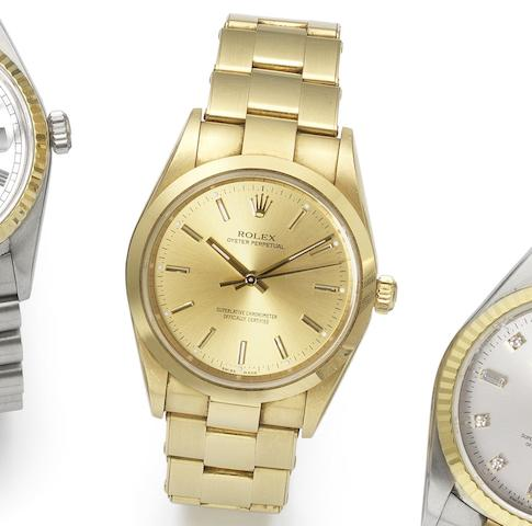 Rolex. An 18ct gold automatic bracelet watch with certificate Oyster Perpetual, Ref:14208M, Serial No.D955***, Sold 7th March 2007
