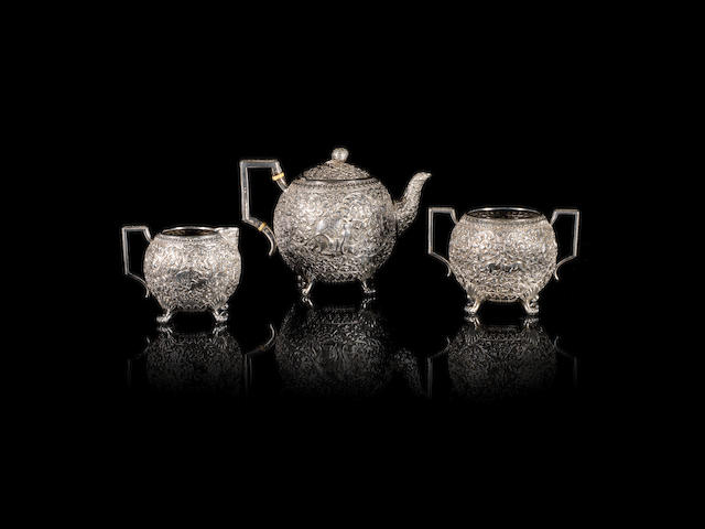 A fine Kutch three-piece silver Tea-Set by Oomersi Mawji & Sons Bhuj, circa 1890(3)