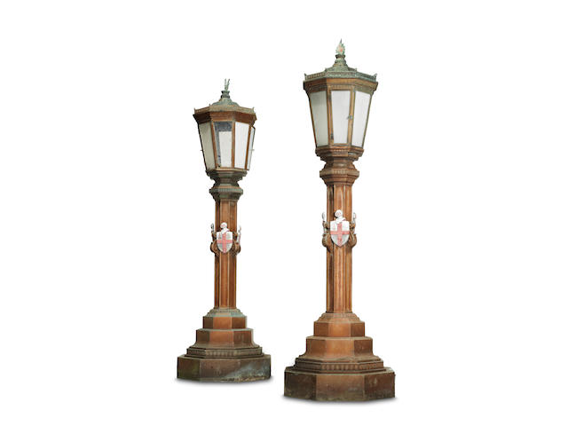 A pair of painted bronze octagonal lamp posts, formerly at The Mansion House by The Cashmore Art Works, circa 1935