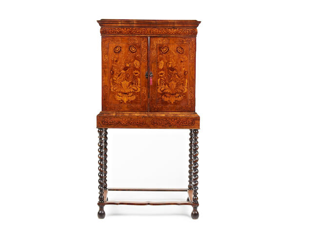 A William and Mary style walnut cabinet on stand