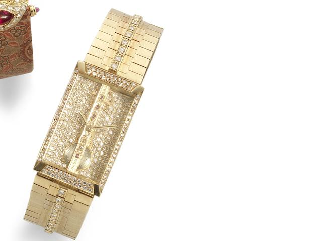 Corum. An unusual 18ct gold manual wind diamond set skeletonised bracelet watch 'Golden Bridge', Ref:13.203.65 HO32, Serial No.351898, Circa 1980