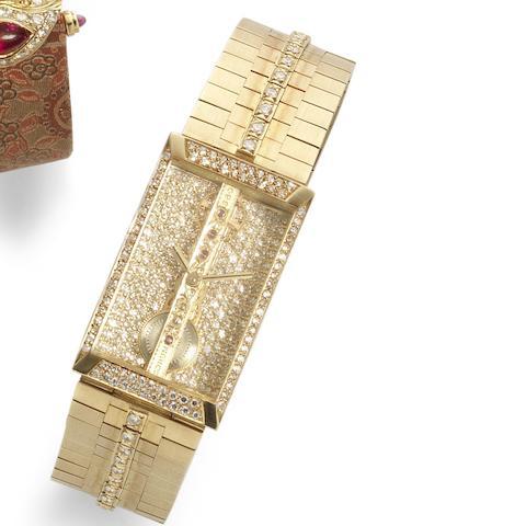 Corum. An unusual 18ct gold manual wind diamond set skeletonised bracelet watch 'Golden Bridge', Ref:13.203.65 HO32, Serial No.351898, Circa 1980