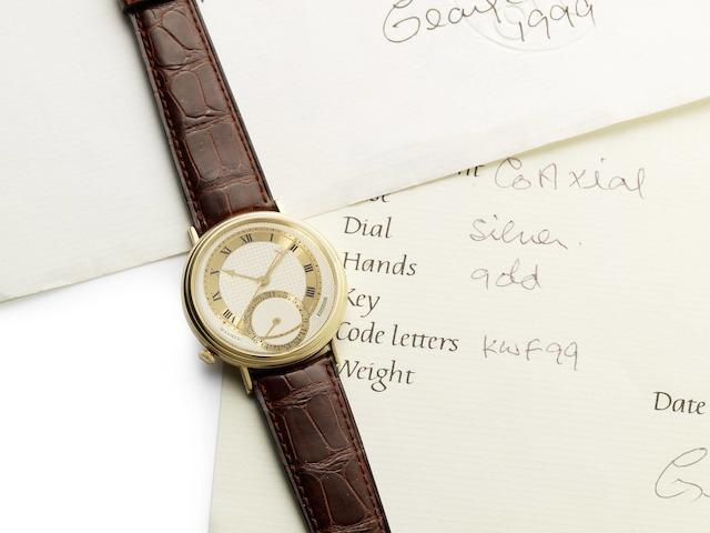 George Daniels. A very fine and rare 18ct yellow gold limited series automatic centre seconds calendar wristwatch with Co-Axial escapement with fitted box, papers and letters signed by George Daniels Millennium, Made in 1999