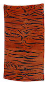 A Tibetan 'tiger' rug 19th century to mid 20th century