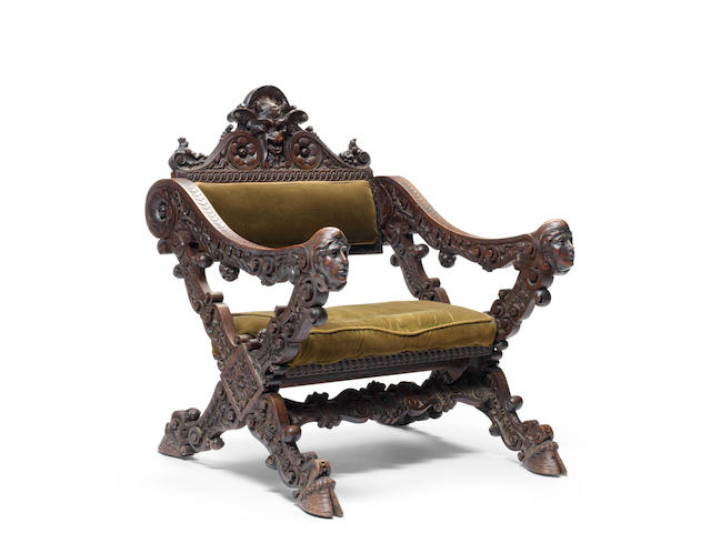 An Italian late 19th century carved walnut Renaissance revival X-frame throne armchair by Luigi Frullini, Firenze