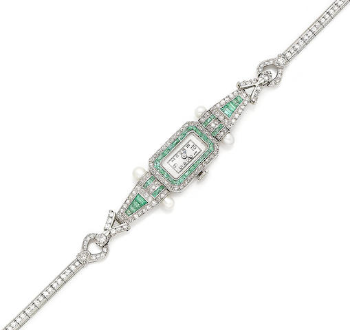 An emerald and diamond wristwatch,