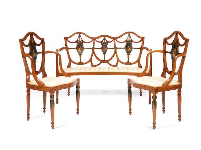 A three piece suite of late Victorian Sheraton revival satinwood and polychrome decorated drawing room furniture