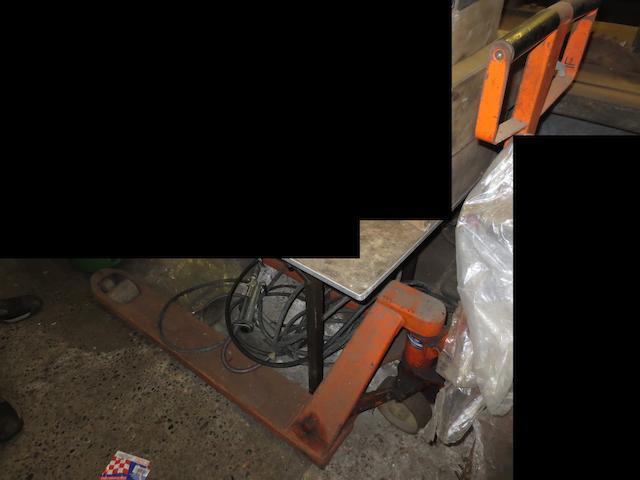 A wheeled pallet jack by Rolatruc,