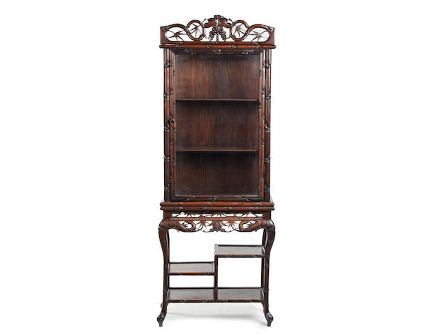 An early 20th Century Chinese hardwood display cabinet on stand