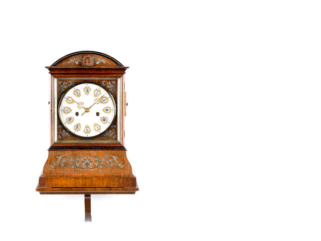 A fine and rare second half of the 19th century Black Forest brass and zinc inlaid walnut cuckoo clock with alabaster dial on a wall bracket Attributed to Johann Baptist Beha, Eisenbach