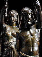 François-Christophe-Armand Toussaint (1806-1862) A large pair of French mid-19th century gilt and patinated bronze figural torchères: Esclave Indien and Esclave Indienne cast by F. Barbedienne (before 1869) from models by Toussaint dated 1850
