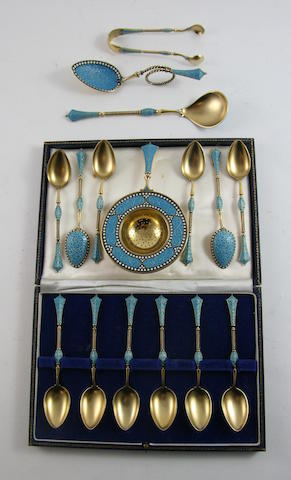 David Andersen: A Norwegian silver gilt and enamel set of twelve tea spoons by David Andersen, Oslo circa 1925 (16)