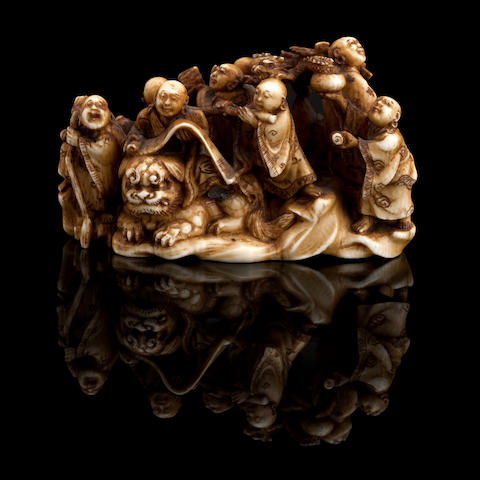 A carved ivory figure netsuke 19th century