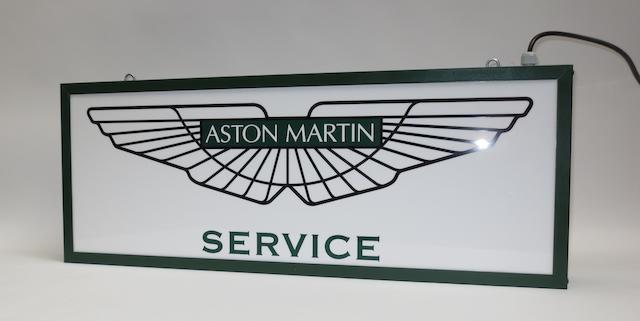 An 'Aston Martin Service' illuminated sign,