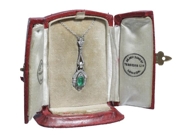 An early 20th century emerald and diamond pendant