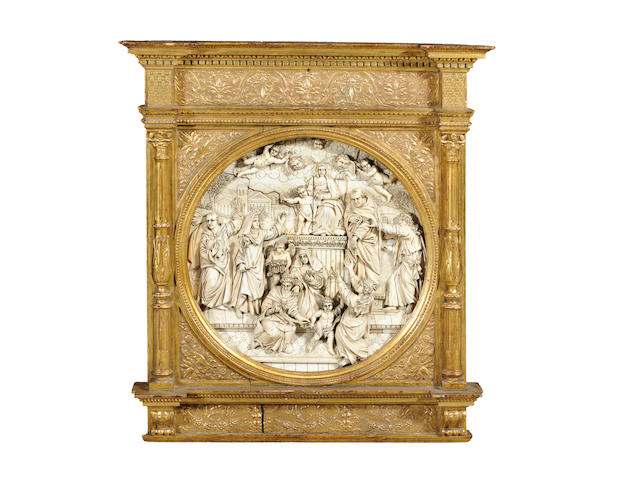 A late 18th century relief carved ivory tondo depicting the Presentation of the Rosary to Saint Dominic probably Italian