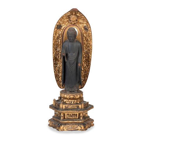 A wood figure of standing Amida Buddha (Amitabha) 19th century