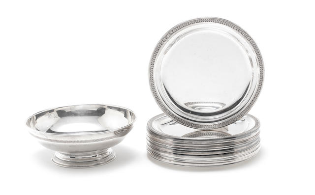 A set of fourteen late 19th / early 20th century Belgian silver dessert plates three, of 925 standard, the remainder, of 835 standard, by Wolfers, Brussels, circa 1900 (15)
