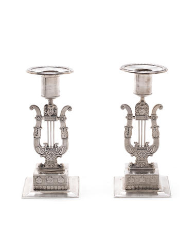 A pair of early 19th century Swedish empire silver candlesticks by Gustaf Folcker, Stockholm 1822