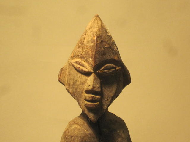 A Lobi bateba figure, two Indonesian masks and a Tanzanian souvenir figure 4